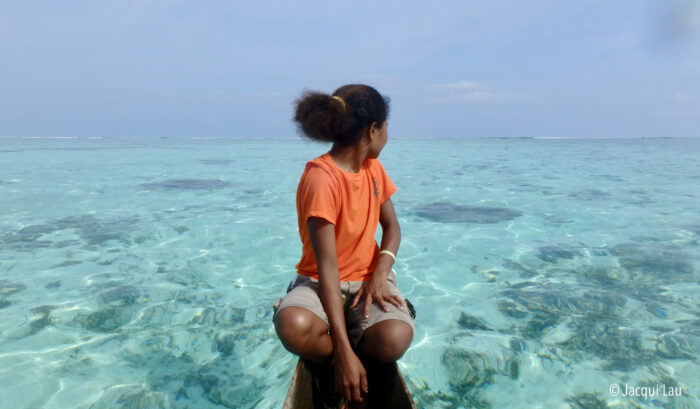 Pursuing gender equality in climate change policy and practice is critical. Image of a woman in the PNG sea by Jacqui Lau.